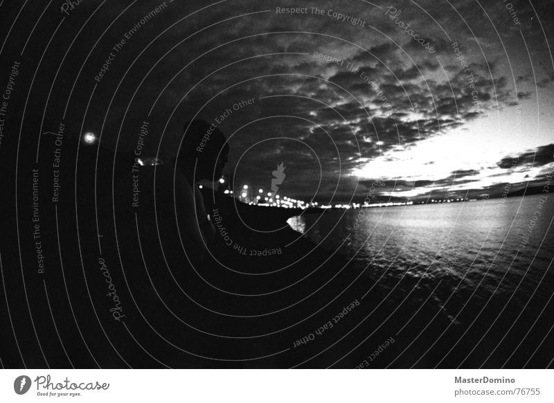 There will be night in Reykjavík Ocean Town Building Iceland Clouds Man Cap Crouch Looking Analog Sky Light Bay Black & white photo Human being