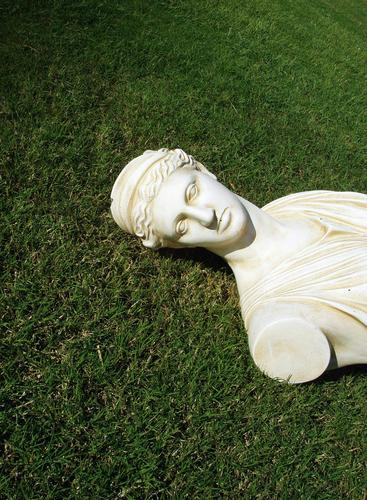 Püppi without arms Deities Green Meadow Grass White Bust Statue Lawn Marble Sculpture Neutral Background Copy Space top Copy Space bottom Historic