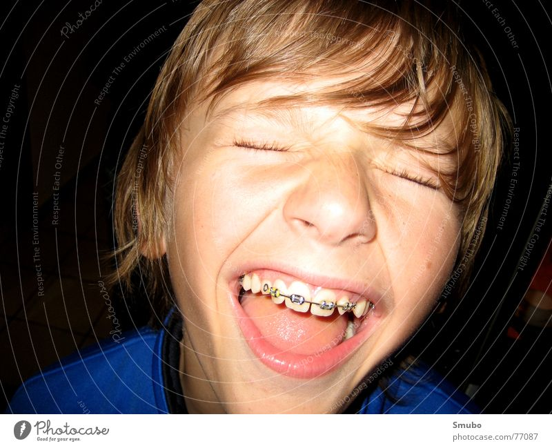 Youth (Young adults) Blue Boy (child) Hair and hairstyles Bright Blonde Mouth 13 - 18 years Scream Partially visible Braces Detail of face Narrowed Brooch