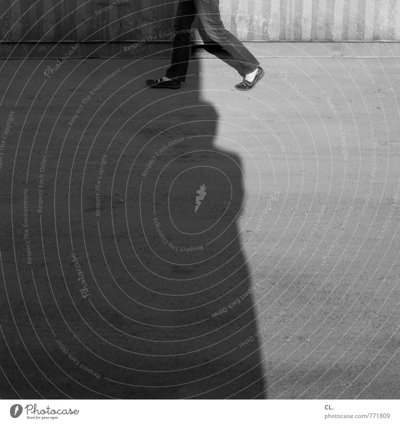 Human being Man Adults Street Movement Lanes & trails Going Walking To go for a walk Uniqueness Target Jeans Pavement Identity Container Pedestrian