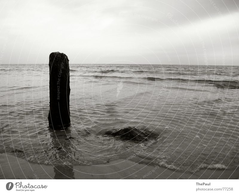 A pole in the surf Ocean Lake Rügen Waves Surf Loneliness Wooden stake Calm Relaxation Exterior shot Gray scale value Baltic Sea Stone thepaul