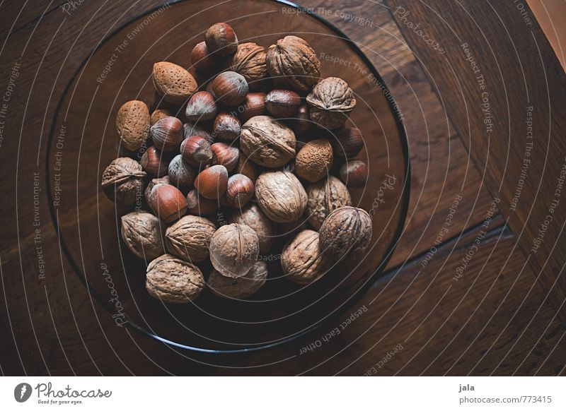 nuts Food Nut Walnut Hazelnut Nutrition Organic produce Vegetarian diet Bowl Healthy Eating Simple Delicious Natural Wooden table Colour photo Interior shot