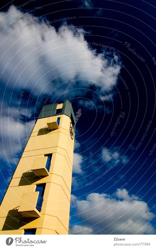 fire tower Building Threat Manmade structures Balcony Window Yellow Small Sky Blue Square Left Fire department Tower Tall Construction site Upward Above big wok