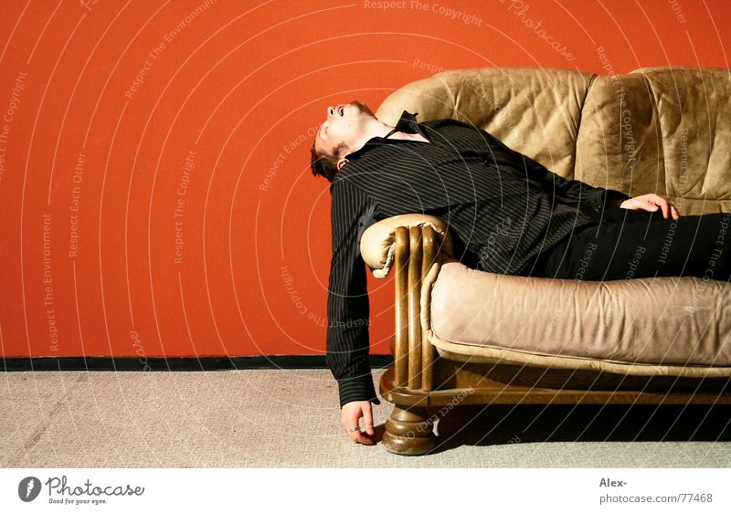 Man Red Black Relaxation Work and employment Wall (building) Dream Flat (apartment) Sleep Sofa Fatigue Living room Leather Fellow Lifeless Oversleep