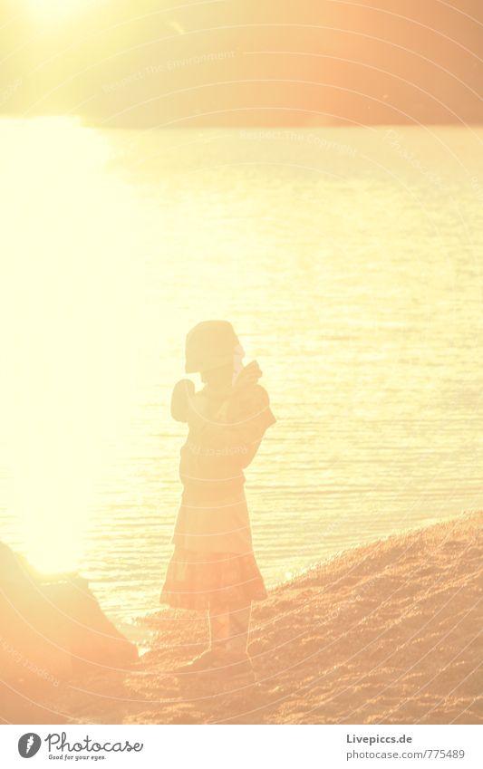 Eda Human being Feminine Girl Body 8 - 13 years Child Infancy Coast Yellow Gold Black Vacation & Travel Colour photo Exterior shot Evening Twilight