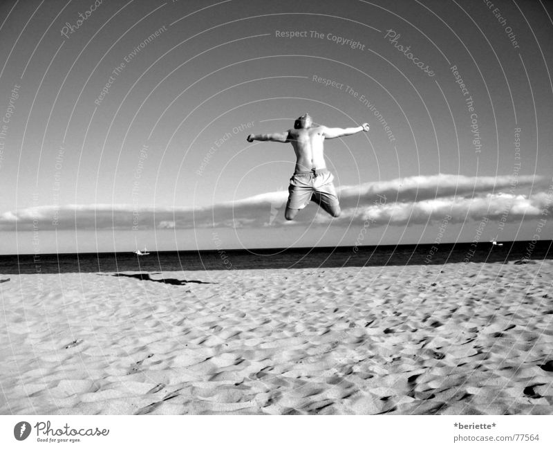 Freedom 1 Man Jump Vacation & Travel Swimming trunks Beach Physics Summer Ocean Wet Salty Sand Warmth Musculature Sky Blue Joy Black & white photo