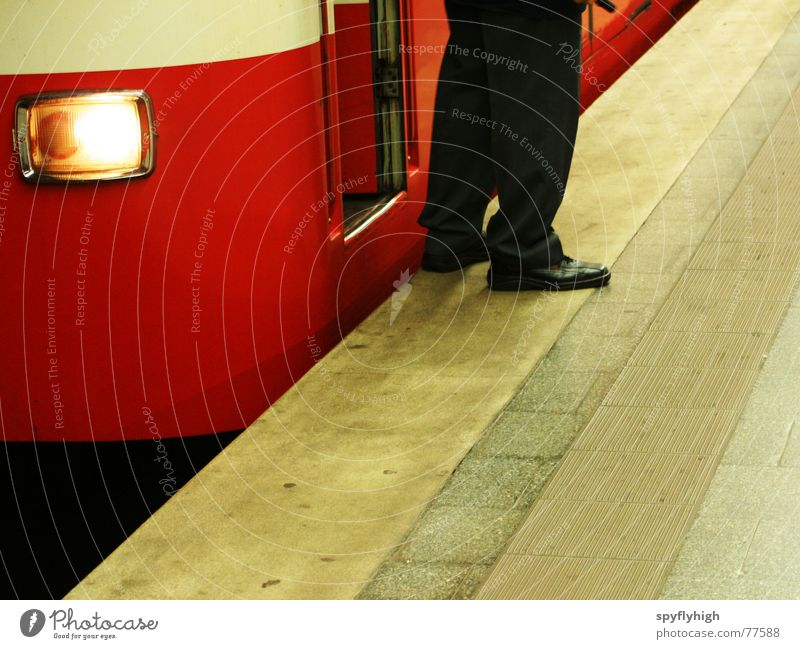 On transit Underground Uniform Footwear Red Stop Concrete Feet subway platform Floodlight Subway station