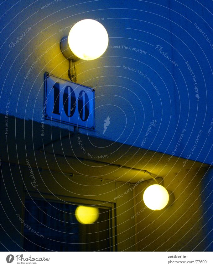 100 Digits and numbers House number Jubilee Light Exterior lighting Glass door Reflection Night Dark Enamel sign Lighting Door Evening Blue Signs and labeling
