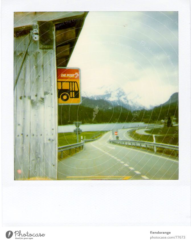 think dra lüt a Switzerland Bus stop Lake Air Signs and labeling Street Mountain snow:loneliness Polaroid