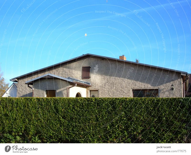 hidden house (haunted) Style Environment Cloudless sky Hedge Marzahn Detached house Window Near Above Blue green Safety Loyal Orderliness Idyll Closed Screening