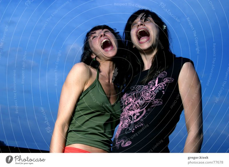 I wanna scream! Crazy Grinning Stupid Human being Portrait photograph Sky Jump Open silly funny Scream two Woman big screech shriek yell mad freeze picture