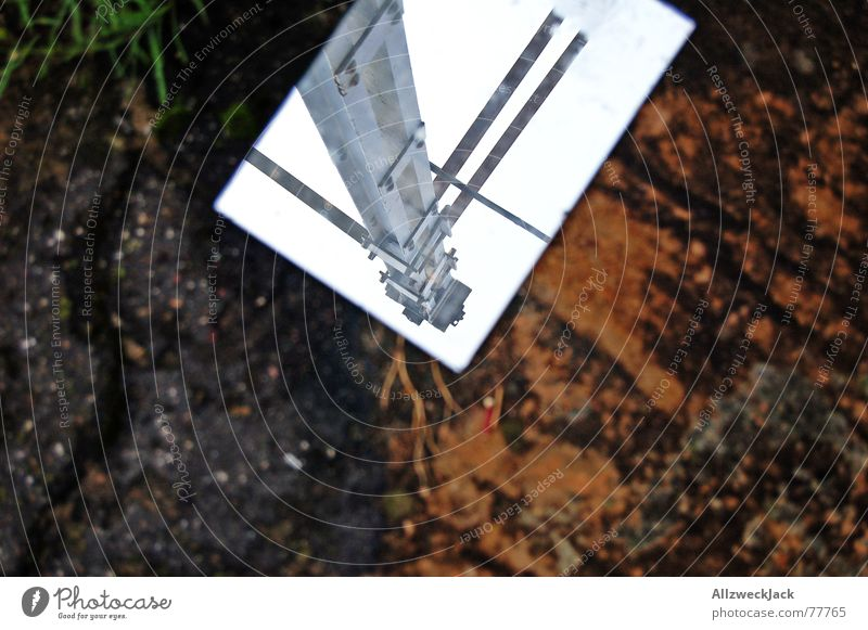 mirror image Mirror Mirror image Asphalt Invalided out Exterior shot Trash Throw away Steel Electricity Electricity pylon Cable Sky Floor covering