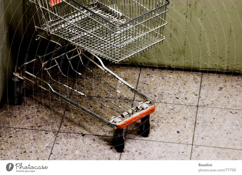 Loneliness Wall (building) Stone Metal Empty Floor covering Logistics Store premises Parking Grating Coil Supermarket Shopping Trolley Push Month Go-kart
