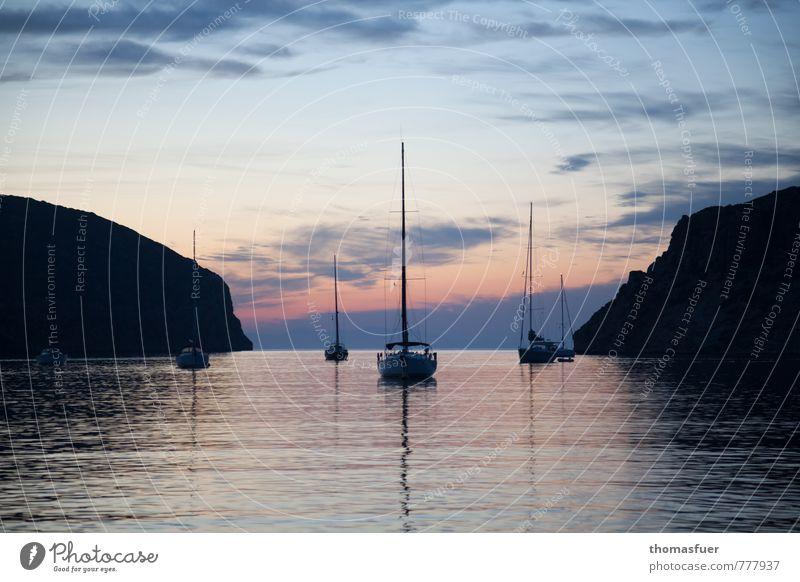 Sky Vacation & Travel Water Summer Ocean Clouds Beach Far-off places Coast Moody Rock Horizon Dream Air Earth Idyll
