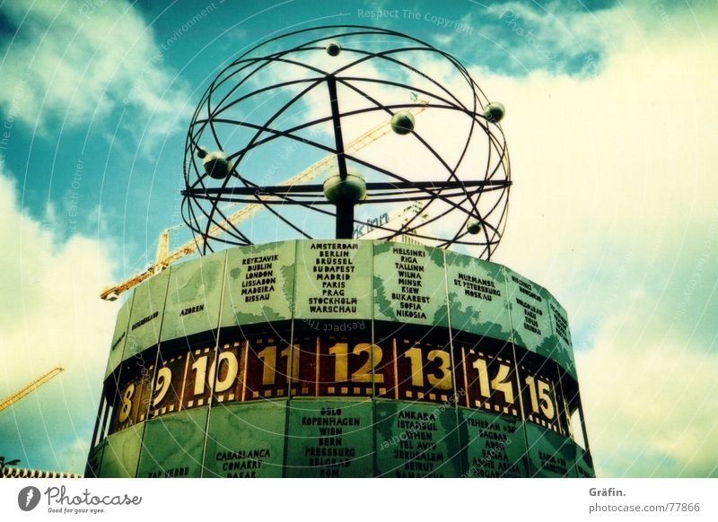 Sky Berlin Architecture Time Clock Construction site Digits and numbers Monument Landmark Crane Work of art Alexanderplatz Lomography World time clock