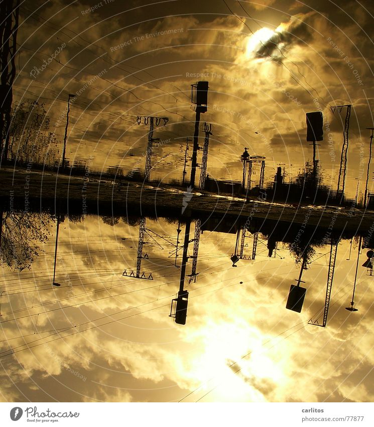 PUTT 2 Puddle Reflection Back-light Overhead line Electricity Railroad tracks Clouds Dramatic Threat Dark Lateness Train station Autumn Electricity pylon