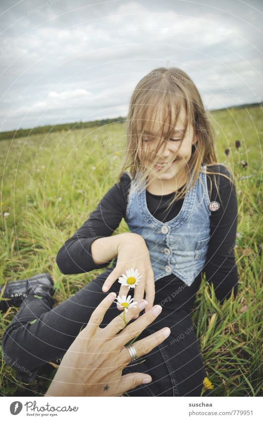 flower children . Child Girl Exterior shot Nature Relaxation Playing Leisure and hobbies Pastime Meadow Spring Sky Horizon Grass Daisy Hand Fingers