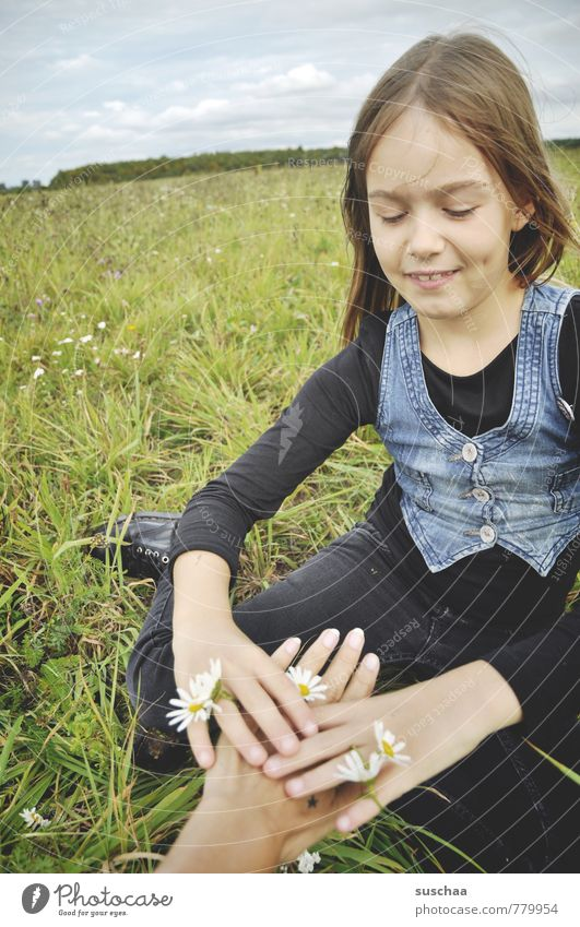 flower children .. Child Girl Face Exterior shot Nature Relaxation Playing Leisure and hobbies Pastime Meadow Spring Sky Horizon Grass Daisy Hand Fingers