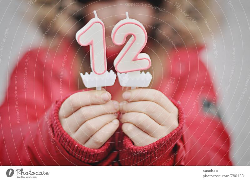 in 12 .. Feminine Child Girl Boy (child) Infancy Body Hand Fingers Human being 8 - 13 years Digits and numbers Red Birthday Jubilee Anticipation Candle Wax