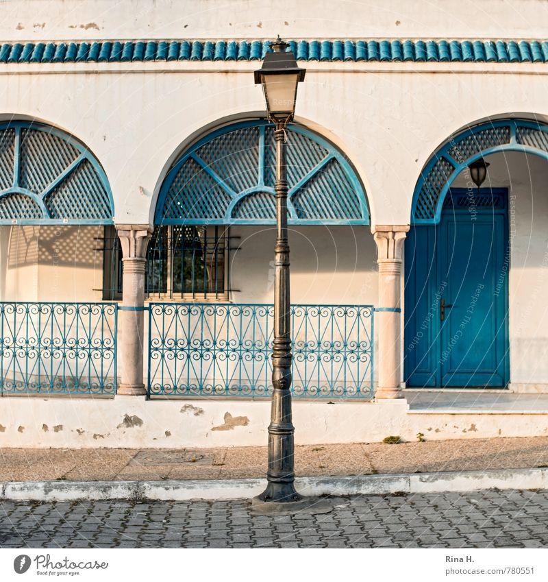 Blue White House (Residential Structure) Window Wall (building) Street Wall (barrier) Door Derelict Sidewalk Square Paving stone Veranda Tunisia Wrought iron