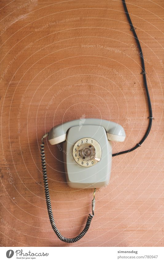 """hello world"" Telephone To call someone (telephone) Old Rotary dial Cable Wall (building) Gray Connection Communicate Accessible Vintage Contact Colour photo"
