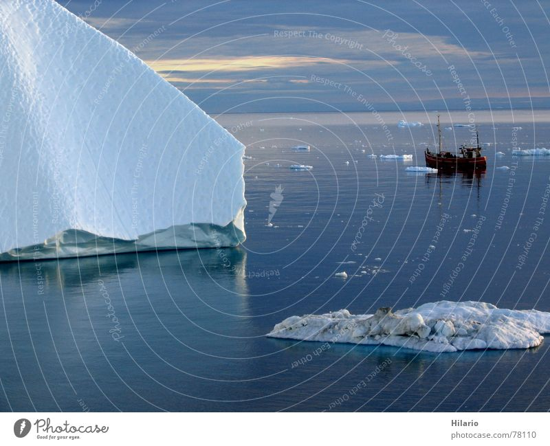 Alone in the ice Greenland Watercraft Ocean Arctic Ocean Iceberg Fishing boat Cold Winter Ice age Clouds White Reflection Horizon Corner Waves Motor barge Calm