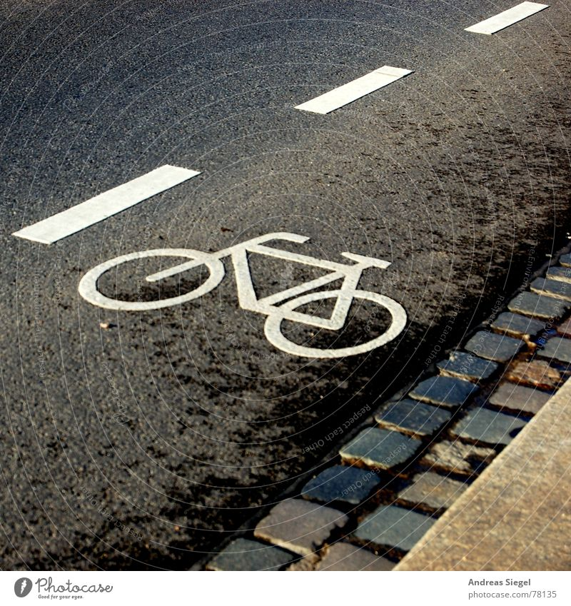 Lanes & trails Line Bicycle Road traffic Signs and labeling Transport Asphalt Tracks Traffic infrastructure Cobblestones Edge Pavement Paving stone Curbside Traffic lane Street sign