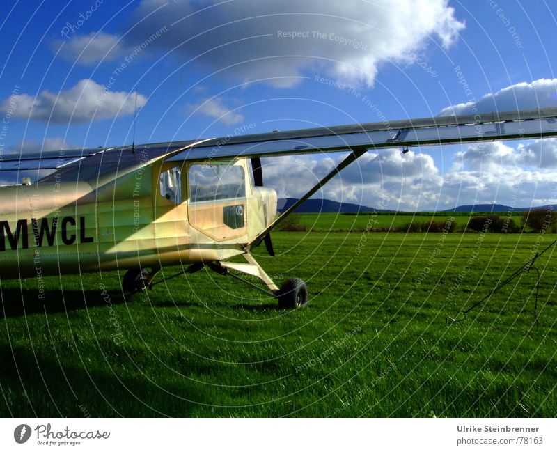 Microlight aircraft on meadow before take-off Leisure and hobbies Aviation Sky Clouds spring Beautiful weather Wind Grass Meadow Field Means of transport