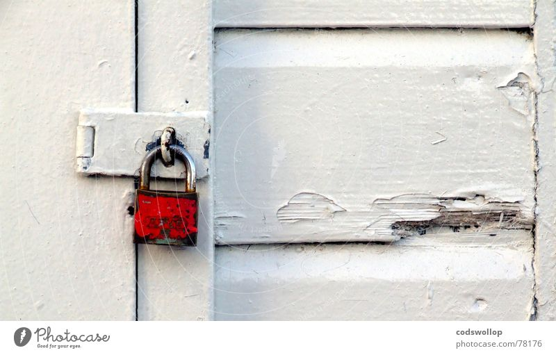 little red padlock Colour photo Exterior shot Detail Copy Space right Copy Space top Copy Space bottom Village Fishing village Hut Wall (barrier)