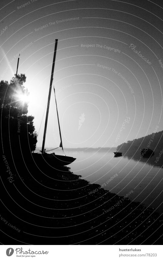 Morning Has Broken Ocean Watercraft Sailing ship Sunrise Twilight Gray scale value Shadow play Reflection Pebble Gravel beach Croatia Vacation & Travel