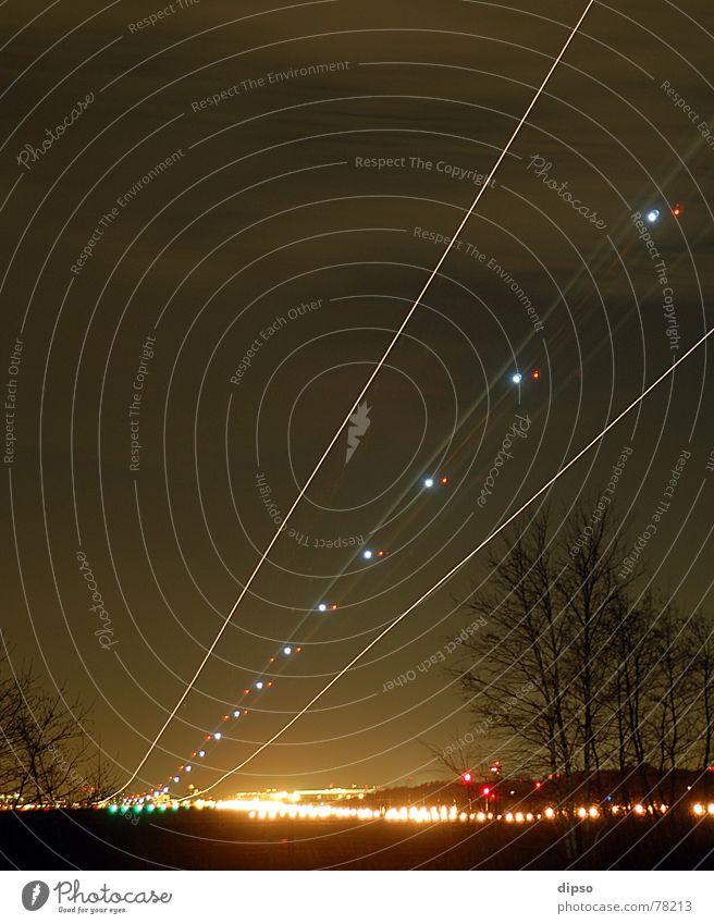 touchdown Airplane Vacation & Travel Wanderlust Tracer path Night shot Engines Airplane landing Jet Light blink jets Beginning glide path