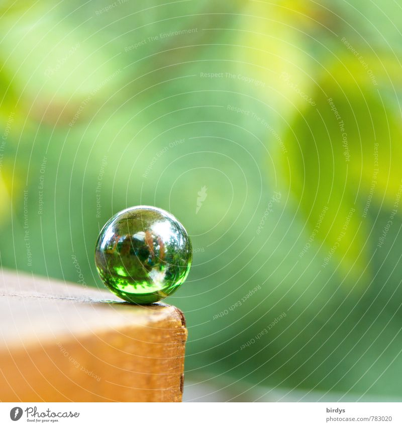critical moment Table edge Marble Glass ball Glittering Esthetic Friendliness Positive Round Green Calm Unwavering Contentment Pure Risk Children's game Sphere