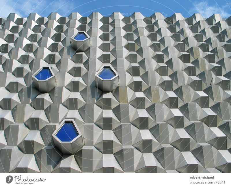 the holy facade Facade Dresden Saxony Hertie Gray Sharp-edged Design Hexagon Corner 6 Clouds Sky Bad weather Prague Shopping district Roof Shopping center