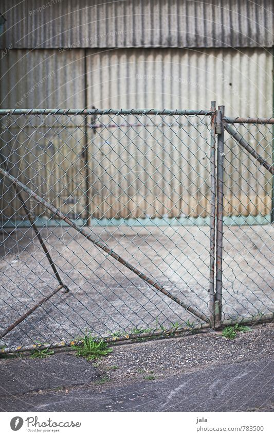 gate Factory Manmade structures Building Facade Door Fence Wire netting fence Gate Corrugated sheet iron Simple Gloomy Town Gray Colour photo Exterior shot