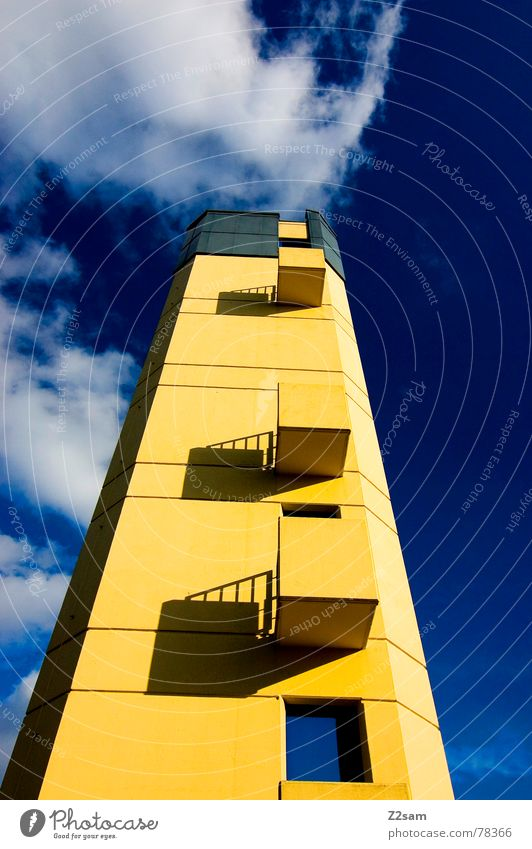 fire tower II Building Threat Manmade structures Balcony Window Yellow Small Sky Blue Square Left Clouds Fire department Tower Tall Construction site Upward