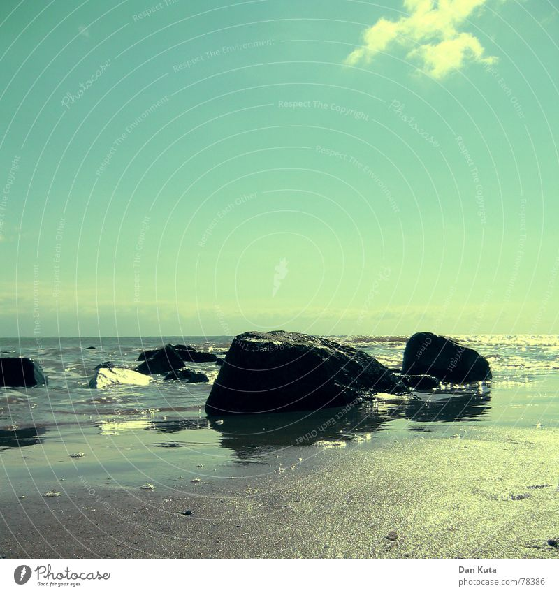 Water Sky Ocean Blue Beach Far-off places Death Happy Stone Sand Coast Waves Glittering Grief Floor covering Transience