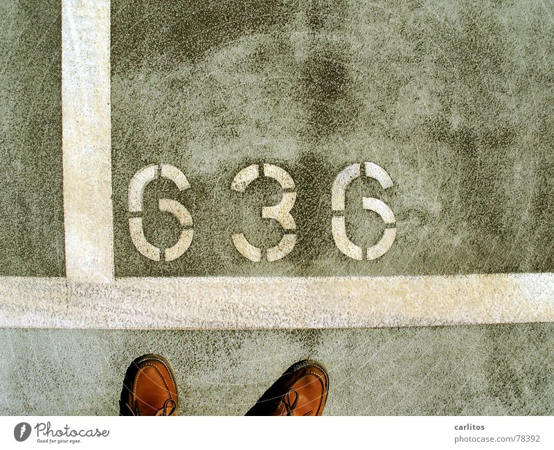 Gray Feet Footwear Line Signs and labeling Concrete Corner Digits and numbers Airport Traffic infrastructure Parking lot Parking garage Mobile home Rough