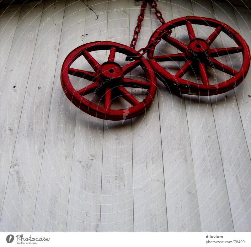 red wheels Red Wood Wall (building) White Carriage Hang Chain Old Varnish Contrast Shadow