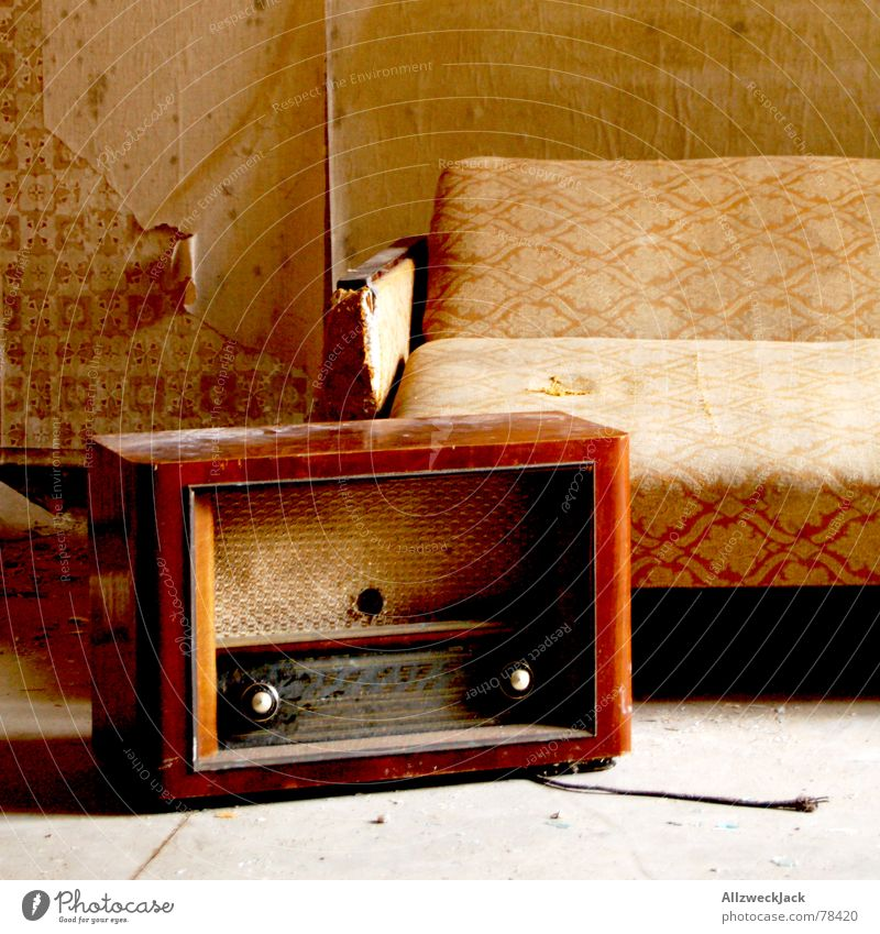 feel-good corner Radio (device) Sofa bed Medium wave Couch East Seventies Wallpaper Scrap Dust Dirty Still Life Untidy wallpaper fragment Old Loneliness grumpy