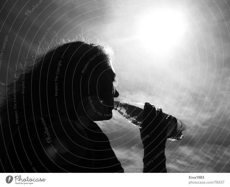 Summer Feeling Woman Black White Drinking Patch of light Exterior shot Physics Cooling Black & white photo Bottle Water Shadow Silhouette Sun Sky Contrast
