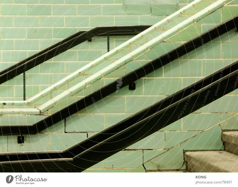 going down Under Downward Underground Go up Diagonal Green Black Train station Line Stairs Tile staircase lines handrail Above Ladder stagger Tall Crazy Tilt