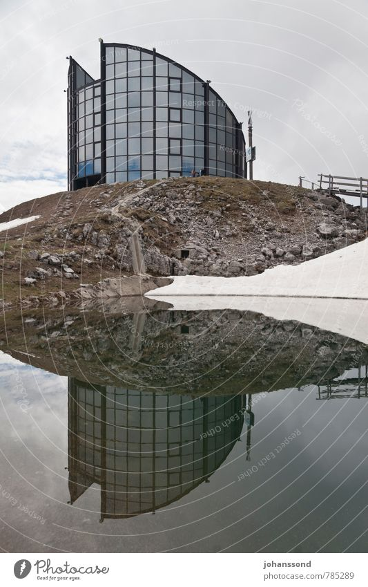 mirroring Architecture Landscape Water Clouds Spring Snow Mountain Lakeside Pond leysin Revolving restaurant Modern architecture Facade Window Hiking Esthetic