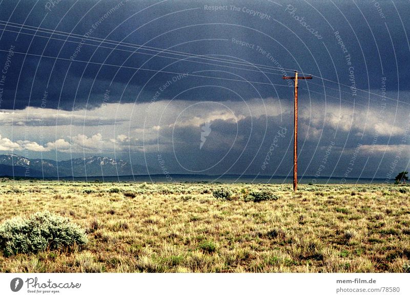 thundery mood 1 Sky Badlands Gloomy Exterior shot Clouds Sun Electricity pylon Steppe Telegraph pole Utah Dark USA Rain Americas Light Thundery shower Desert