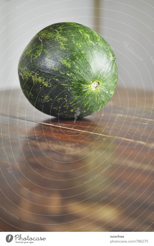 melon head Food Vegetable Nutrition Vegetarian diet Fresh Healthy Delicious Round Juicy Green Melon Fruit Subdued colour Interior shot Deserted