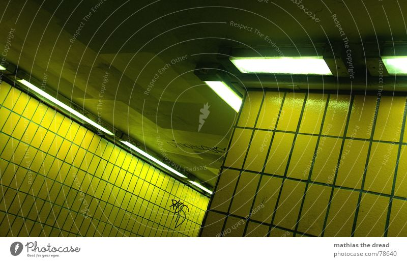 yellow shift Furrow Small sausage Pedestrian underpass Yellow Sharp-edged Wall (barrier) Wall (building) Hard Cold Physics Lamp Light Dark Loneliness