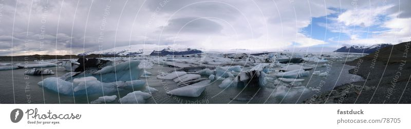Fragments of cold Iceberg April Iceland Glacier Panorama (View) Ocean Water Snow Large Panorama (Format)