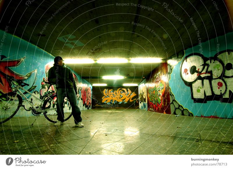 Underpass I Tagger Neon light Mural painting Man Reflection Tunnel Fellow Fluorescent Lights bicycle Human being Guy Graffiti