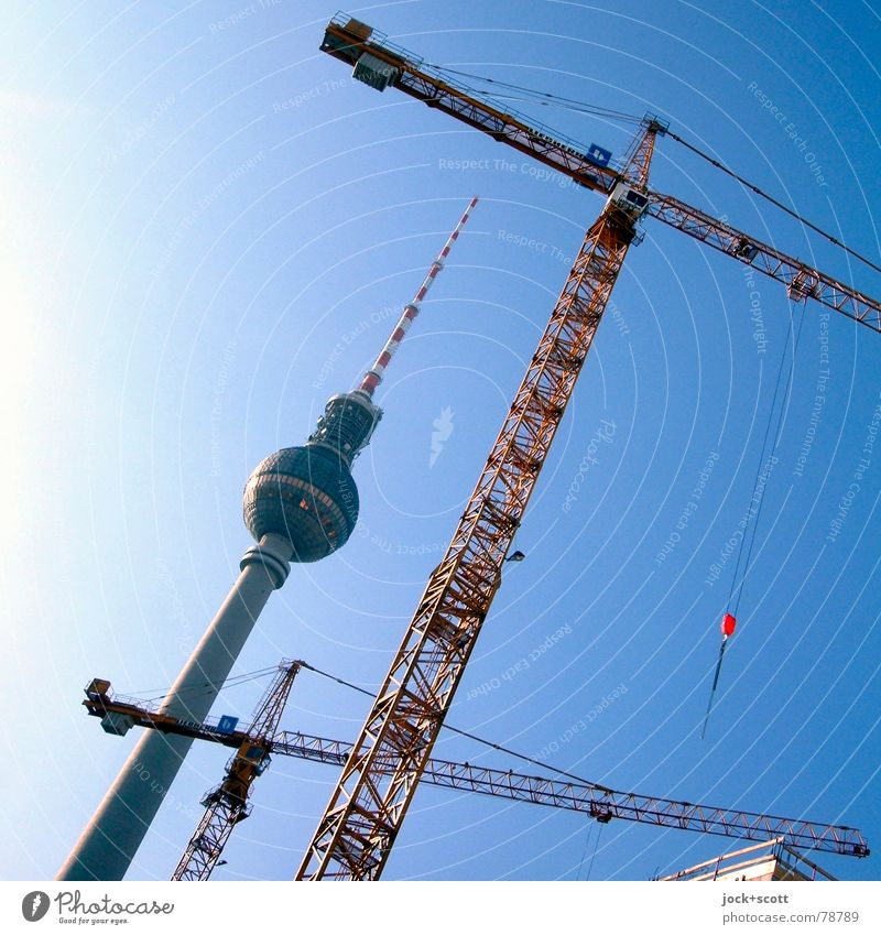 Berlin tv-tower and tower crane Old Blue Summer Architecture Work and employment Growth Tall Crazy Beginning Point Construction site Tilt Level