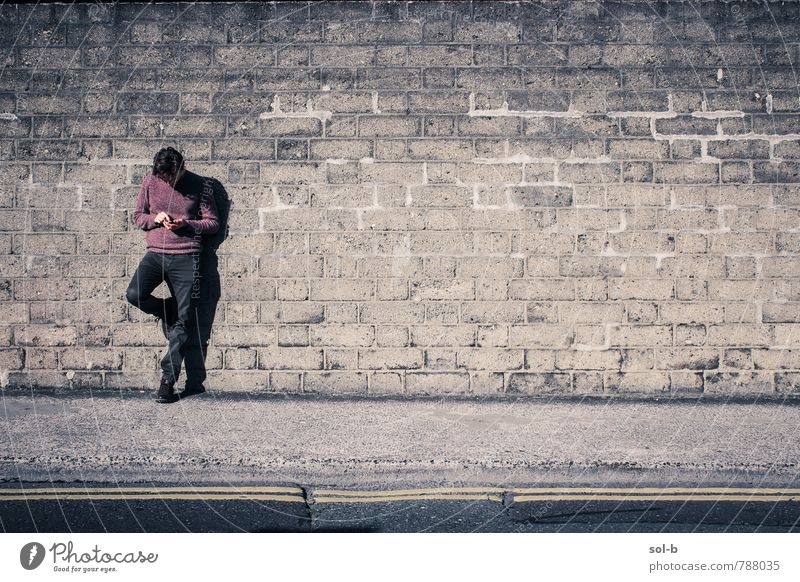 distracted Lifestyle To talk Masculine Young man Youth (Young adults) 1 Human being 18 - 30 years Adults Wall (barrier) Wall (building) Street Think Stand Wait