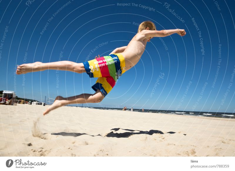 Jump for joy Joy Beach Success Boy (child) 1 Human being 8 - 13 years Child Infancy Sky Cloudless sky Summer coast Baltic Sea Swimming trunks Movement Flying